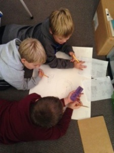Students work together to research and present particular ecosystems to the class.