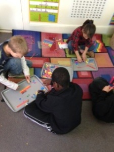 Jubilee Academy students use compare fractions using manipulatives.